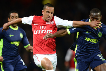 LONDON, ENGLAND - APRIL 16:  Theo Walcott of Arsenal is challenged by Maynor Figueroa of Wigan during the Barclays Premier League match between Arsenal and Wigan Athletic at Emirates Stadium on April 16, 2012 in London, England.  (Photo by Laurence Griffi