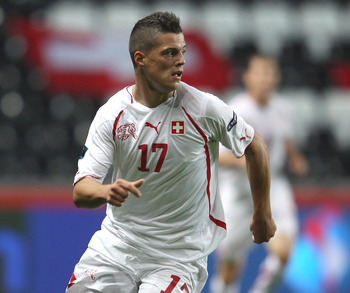 SWANSEA, WALES - OCTOBER 07:  Granit Xhaka of Switzerland during the EURO 2012 Qualifying Group G match between Wales and Switzerland at the Liberty Stadium on October 7, 2011 in Swansea, Wales.  (Photo by Michael Steele/Getty Images)