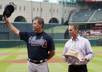 Craig Biggio presenting Chipper Jones a retirement gift.