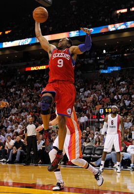 MIAMI, FL - JANUARY 21: Andre Iguodala #9 of the Philadelphia 76ers drives to the rim during a game against the Miami Heat at American Airlines Arena on January 21, 2012 in Miami, Florida. NOTE TO USER: User expressly acknowledges and agrees that, by down