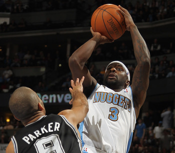 DENVER, CO - MARCH 23:  Ty Lawson #3 of the Denver Nuggets takes a shot over Tony Parker #9 of the San Antonio Spurs at the Pepsi Center on March 23, 2011 in Denver, Colorado. The Nuggets defeated the Spurs 115-112. NOTE TO USER: User expressly acknowledg