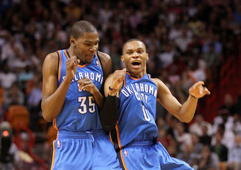 MIAMI, FL - MARCH 16:  Kevin Durant #35 and Russell Westbrook #0 of the Oklahoma City Thunder celebrate after a 3 pointer during a game against the Miami Heat at American Airlines Arena on March 16, 2011 in Miami, Florida. NOTE TO USER: User expressly ack