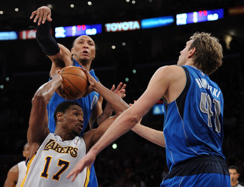 LOS ANGELES, CA - APRIL 15:  Andrew Bynum #17 of the Los Angeles Lakers attempts a shot as he is defended by Shawn Marion #0 and Dirk Nowitzki #41 of the Dallas Mavericks during the first half at Staples Center on April 15, 2012 in Los Angeles, California