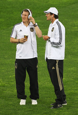 DURBAN, SOUTH AFRICA - JULY 07: Bastian Schweinsteiger and Mario Gomez of Germany enjoy the atmosphere prior to the 2010 FIFA World Cup South Africa Semi Final match between Germany and Spain at Durban Stadium on July 7, 2010 in Durban, South Africa.  (Ph
