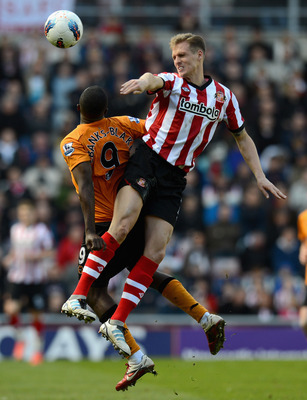 SUNDERLAND, ENGLAND - APRIL 14:  Matthew Kilgallon of Sunderland beats Sylvan Ebanks-Blake of Wolves to the ball during the Barclays Premier League match between Sunderland and Wolverhampton Wanderers at Stadium of Light on April 14, 2012 in Sunderland, E