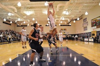 Zach Peters dunking, courtesy of ljworld.com