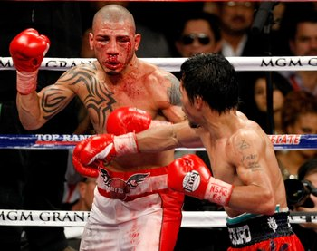 Miguel Cotto being beaten bloody by Manny Pacquiao