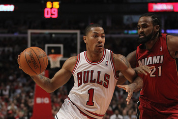 CHICAGO, IL - APRIL 12: Derrick Rose #1 of the Chicago Bulls drives against Ronny Turiaf #21 of the Miami Heat at the United Center on April 12, 2012 in Chicago, Illinois. The Bulls defeated the Heat 96-86 in overtime. NOTE TO USER: User expressly acknowl