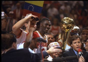 Hakeem Olajuwon and the Houston Rockets celebrate their second championship in a row.