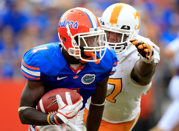 GAINESVILLE, FL - SEPTEMBER 17:  Running back Chris Rainey #1 of the Florida Gators is chased by defensive lineman Malik Jackson #97 of the Tennessee Volunteers during a game at Ben Hill Griffin Stadium on September 17, 2011 in Gainesville, Florida.  (Pho