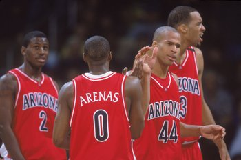 15 Feb 2001:  Gilbert Arenas #9 of the Arizona Wildcats congratulates teammates Michael Wright #2, Richard Jefferson #44, Loren Woods #3 during the game against the University of California, Los Angeles (UCLA) Bruins at the Pauley Pavilion in Los Angeles,