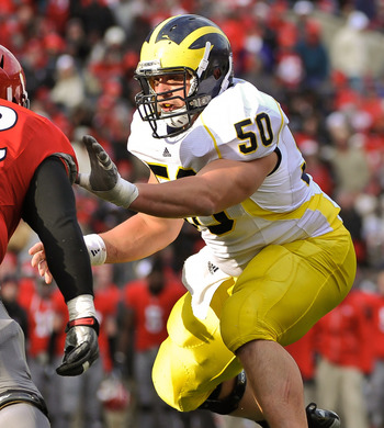 COLUMBUS, OH - NOVEMBER 27:  David Molk #50 of the Michigan Wolverines blocks against the Ohio State Buckeyes at Ohio Stadium on November 27, 2010 in Columbus, Ohio.  (Photo by Jamie Sabau/Getty Images)
