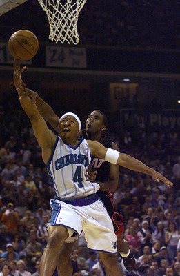 27 Apr 2001:  David Wesley #4 of the Charlotte Hornets gets a basket and a foul over Eddie Jones #6 of the Miami Heat during the first half of Game 3 during the First Round of the NBA Playoffs at Charlotte Coliseum in Charlotte, North Carolina.  <<DIGITAL