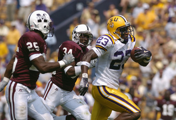 NEW ORLEANS, LA - SEPTEMBER 25:  Wide receiver Xavier Carter #23 of Louisiana State University runs upfield from Mississippi State University defensive backs Slovakia Griffith #25 and Jeramie Johnson #34 during the game on Saturday September 25, 2004, at
