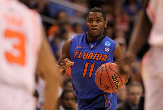 PHOENIX, AZ - MARCH 24:  Erving Walker #11 of the Florida Gators moves the ball up court while taking on the Louisville Cardinals during the 2012 NCAA Men's Basketball West Regional Final at US Airways Center on March 24, 2012 in Phoenix, Arizona.  (Photo