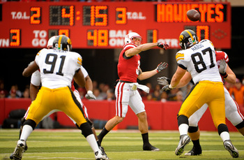 LINCOLN, NE - NOVEMBER 25: Quarterback Taylor Martinez #3 of the Nebraska Cornhuskers throws over the Iowa Hawkeyes during their game at Memorial Stadium November 25, 2011 in Lincoln, Nebraska. Nebraska defeated Iowa 20-7. (Photo by Eric Francis/Getty Ima