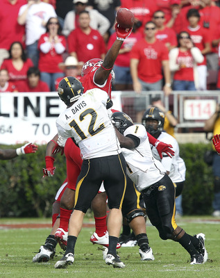 HOUSTON - DECEMBER 03:  Quarterback Austin Davis #12 of the Southern Mississippi Golden Eagles has his pass knocked down at the line of scrimmage during the game against the Houston Cougars at Robertson Stadium on December 3, 2011 in Houston, Texas.  (Pho