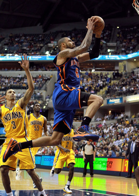 INDIANAPOLIS, IN - APRIL 03:  Tyson Chandler #6 of the New York Knicks shoots the ball during the NBA game against the Indiana Pacers at Bankers Life Fieldhouse on April 3, 2012 in Indianapolis, Indiana. NOTE TO USER: User expressly acknowledges and agree