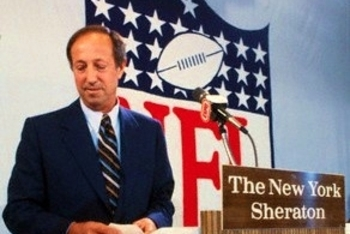 Commissioner Pete Rozelle prepares to announce the first draft pick by the Baltimore Colts in 1983.