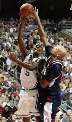 Daniel Ewing's shot is blocked by Charlie Villanueva during UConn's 79-78 Final Four win over the Blue Devils.