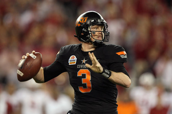 GLENDALE, AZ - JANUARY 02:  Brandon Weeden #3 of the Oklahoma State Cowboys throws a pass against the Stanford Cardinal during the Tostitos Fiesta Bowl on January 2, 2012 at University of Phoenix Stadium in Glendale, Arizona.  (Photo by Donald Miralle/Get