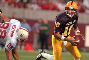 Arizona State quarterback Jake Plummer eludes Nebraska defensive end Grant Wistrom in their game in 1996. The Sun Devils beat the Huskers 16-0. It was the last time Nebraska was shut out.