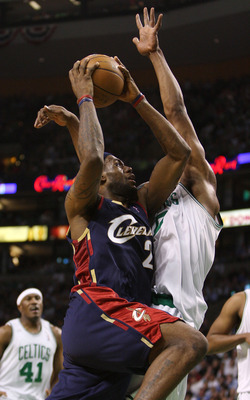 BOSTON - MAY 8:  LeBron James #23 of the Cleveland Cavaliers takes a shot as Leon Powe #0 of the Boston Celtics defends during Game Two of the Eastern Conference Semifinals during the 2008 NBA Playoffs at the TD Banknorth Garden May 8, 2008 in Boston, Mas