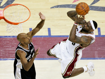 CLEVELAND - JUNE 14:  LeBron James #23 of the Cleveland Cavaliers goes in for a layup against Bruce Bowen #12 of the San Antonio Spurs during Game Four of the NBA Finals on June 14, 2007 at the Quicken Loans Arena in Cleveland, Ohio. NOTE TO USER: User ex