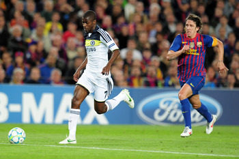 Ramires gets past Puyol.