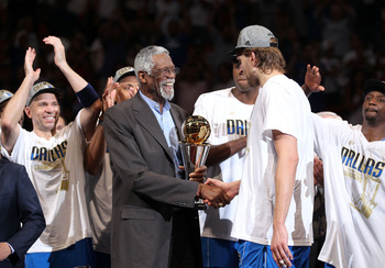 Dirk Nowitzki the 2011 NBA Finals MVP shakes hands with the legendary Bill Russell.