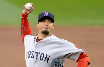 Despite three walks, Josh Beckett notched his second win of the season for the Red Sox.