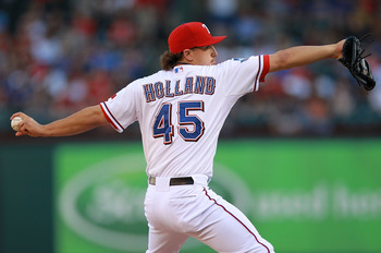 ARLINGTON, TX - APRIL 23:  Derek Holland #45 of the Texas Rangers throws against the New York Yankees at Rangers Ballpark in Arlington on April 23, 2012 in Arlington, Texas.  (Photo by Ronald Martinez/Getty Images)