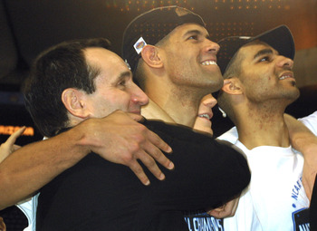 Coach Mike Krzyzewski, Shane Battier and Carlos Boozer celebrate after winning the 2001 NCAA Championship.