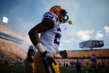 BATON ROUGE, LA - OCTOBER 08:  David Jenkins #25 of the Louisiana State University Tigers  runs onto the field before playing the Florida Gators at Tiger Stadium on October 8, 2011 in Baton Rouge, Louisiana.  (Photo by Chris Graythen/Getty Images)