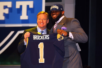 NEW YORK, NY - APRIL 26:  Michael Brockers (R) of LSU holds up a jersey as he stands on stage with NFL Commissioner Roger Goodell after he was selected #14 overall by the St. Louis Rams in the first round of the 2012 NFL Draft at Radio City Music Hall on