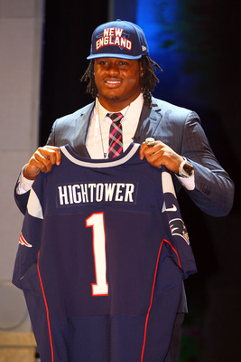 NEW YORK, NY - APRIL 26:  Dont'a Hightower of Alabama holds up a jersey as he stands on stage after he was selected #25 overall by the New England Patriots in the first round of the 2012 NFL Draft at Radio City Music Hall on April 26, 2012 in New York Cit