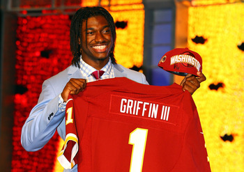 NEW YORK, NY - APRIL 26:  Robert Griffin III from Baylor holds up a jersey as he stands after Griffin was selected #2 overall by the Washington Redskins in the first round of the 2012 NFL Draft at Radio City Music Hall on April 26, 2012 in New York City. 
