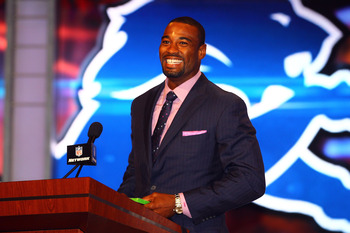 NEW YORK, NY - APRIL 26:  Calvin Johnson of the Detroit Lions and 2013 EA Sports Madden Football cover player announces the Lions pick during the 2012 NFL Draft at Radio City Music Hall on April 26, 2012 in New York City.  (Photo by Al Bello/Getty Images)