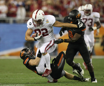 Coby Fleener breaks a tackle in the 2012 Fiesta Bowl between Stanford and Oklahoma State.