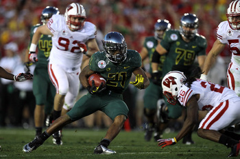 LaMichael James jukes a Wisconsin Badger during Oregon's 2012 Rose Bowl win over Wisconsin.