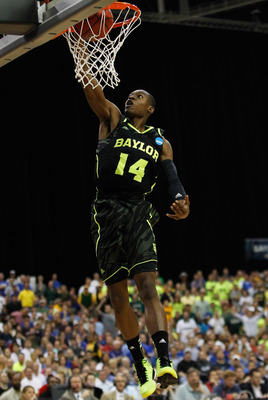 ATLANTA, GA - MARCH 25:  Deuce Bello #14 of the Baylor Bears dunks against the Kentucky Wildcats during the 2012 NCAA Men's Basketball South Regional Final at the Georgia Dome on March 25, 2012 in Atlanta, Georgia.  (Photo by Streeter Lecka/Getty Images)
