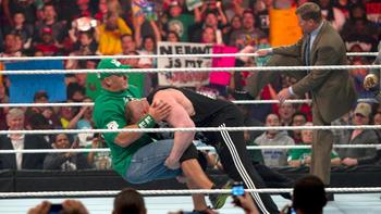 Brock Lesnar wth a double leg takedown on John Cena. Courtesy: WWE.com.