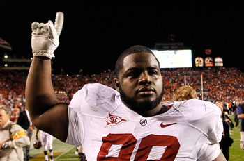 AUBURN, AL - NOVEMBER 26:  Josh Chapman #99 of the Alabama Crimson Tide celebrates their 42-14 win over the Auburn Tigers at Jordan-Hare Stadium on November 26, 2011 in Auburn, Alabama.  (Photo by Kevin C. Cox/Getty Images)