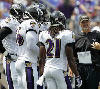 BALTIMORE, MD - AUGUST 06: Baltimore Ravens head coach John Harbaugh (R) and defensive coordinator Chuck Pagano (C) talk with the defense during training camp at M&T Bank Stadium on August 6, 2011 in Baltimore, Maryland.  (Photo by Rob Carr/Getty Images)