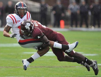 Safety Charles Smith with the hard tackle (photo courtesy of the Clarion-Ledger).
