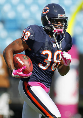 CHARLOTTE, NC - OCTOBER 10: Safety Danieal Manning #38 of the Chicago Bears runs with the ball during warm ups prior to the Bears game against the Carolina Panthers at Bank of America Stadium on October 10, 2010 in Charlotte, North Carolina. (Photo by Geo