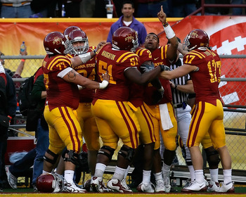 TEMPE, AZ - DECEMBER 31:  Quarterback Austen Arnaud #4 of the Iowa State Cyclones points to the sky in celebration after scoring on a 9 yard rushing touchdown against the Minnesota Golden Gophers during the Insight Bowl at Arizona Stadium on December 31,
