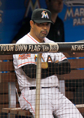 MIAMI, FL - APRIL 29: Manager Ozzie Guillen #13 of the Miami Marlins looks on from the dugout during a game against the Arizona Diamondbacks at Marlins Park on April 29, 2012 in Miami, Florida. The Arizona Diamondbacks defeated the Miami Marlins 8-4. (Pho