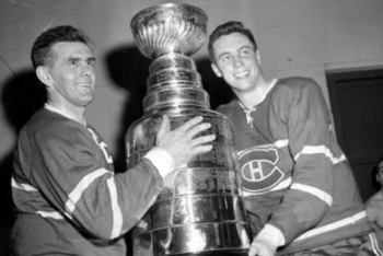 Montréal legends Maurice Richard (left) and Jean Beliveau (right) pose with Lord Stanley's Cup.