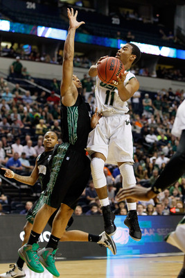Collins takes it to the hole against Ohio. Dig the green shoes.